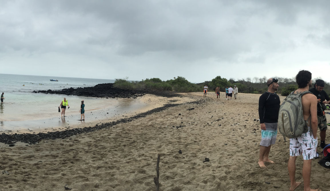 Post Office - Floreana Island in the Galapagos, view of a beach with tourists