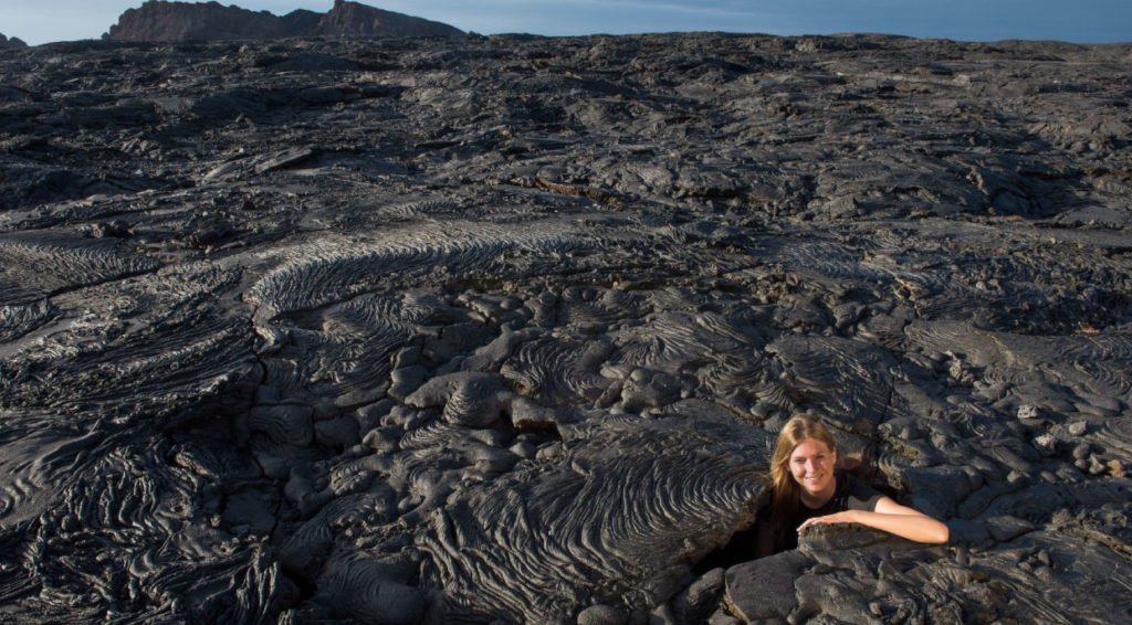 Sullivan bay, solid volcanic lava with tourist girl