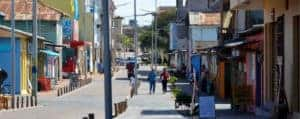 San Cristobal City of Galapagos Island with people walking in the street