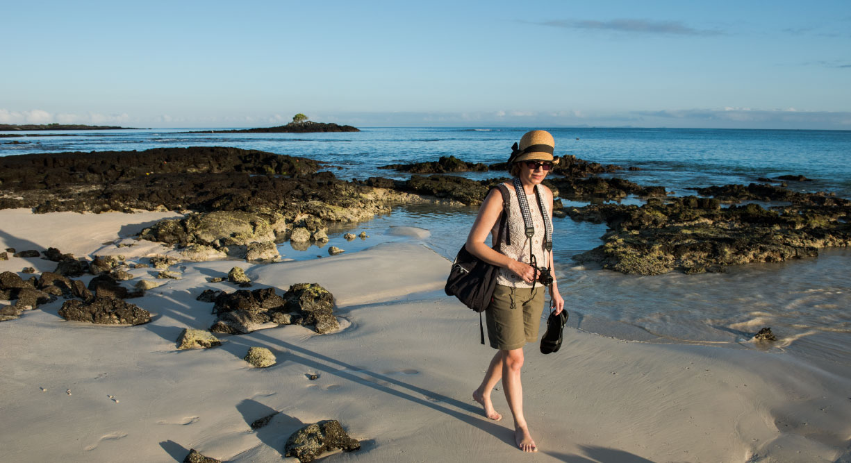 Bachas Beach - Santa Cruz in Galapagos Island beautiful white sand beach and volcanic rocks