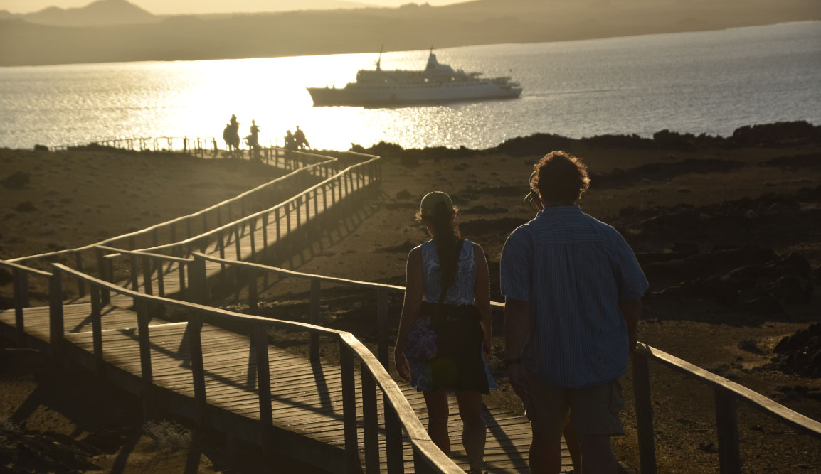 Bartolome in Galapagos Islands, landscape with a road, tourist and a view of the Galapagos Legend in the sea