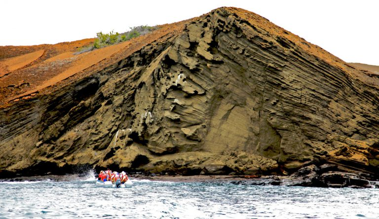 Bartolome in Galapagos Islands landscape with tourist in panga