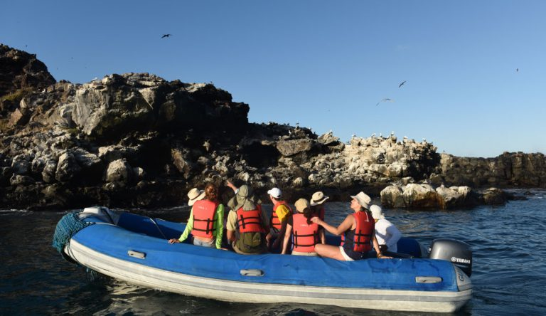 Pitt Point - San Cristobal in Galapagos Islands, view of the tourist in a panga