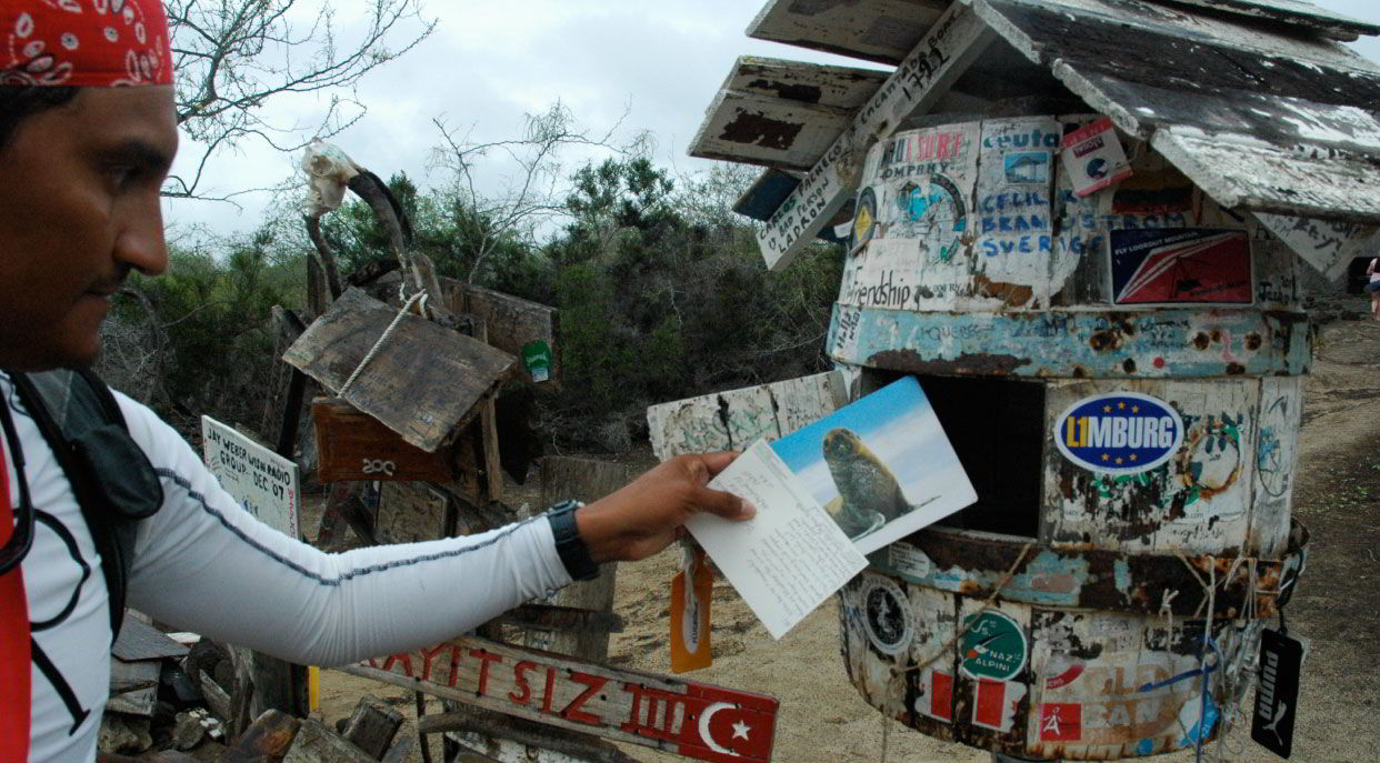 Post Office - Floreana Island in the Galapagos, tourist taking letters and postals