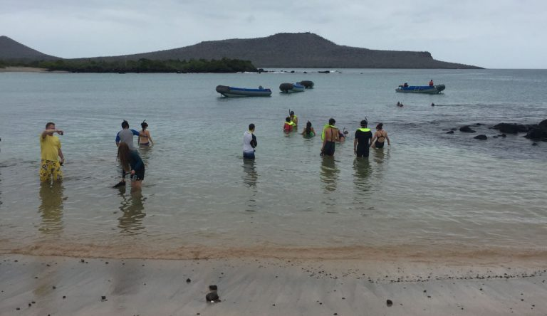 Post Office - Floreana Island in the Galapagos, view of a beach with tourist