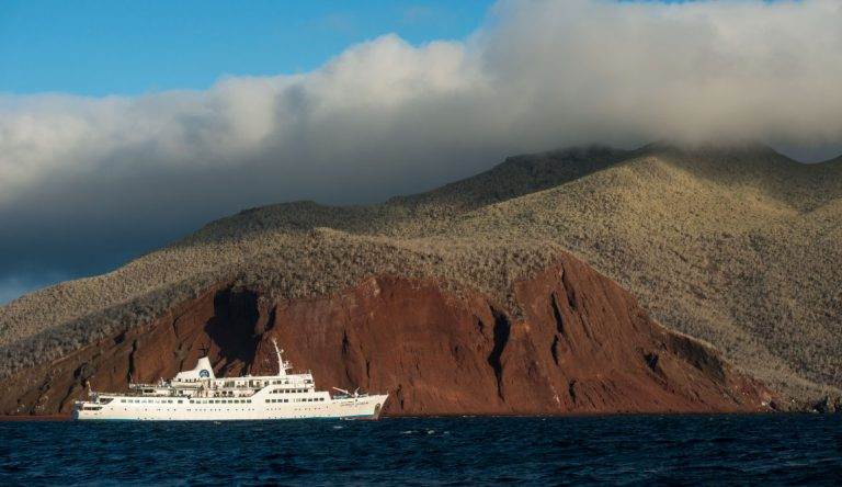 Rabida in Galapagos Islands, view of the red sand with Galapagos Legend