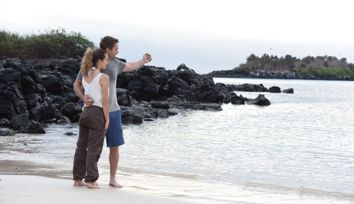 Santa Fe in Galapagos Island with Tourist on the beach