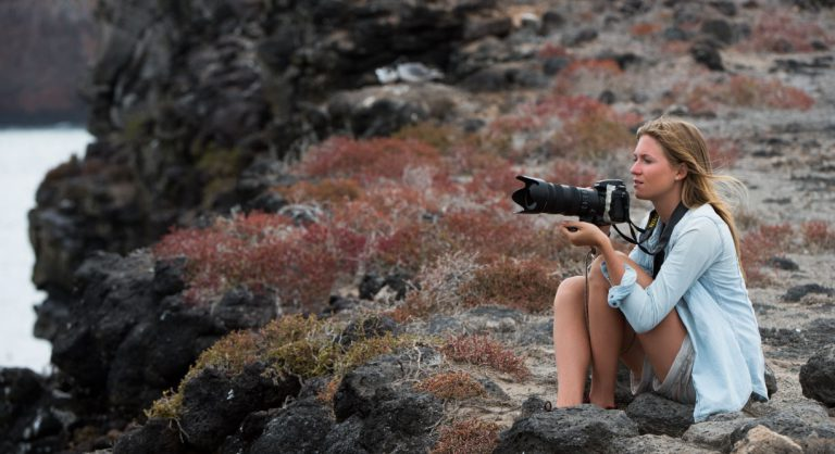 South Plaza in the Galapagos island with photographer tourist