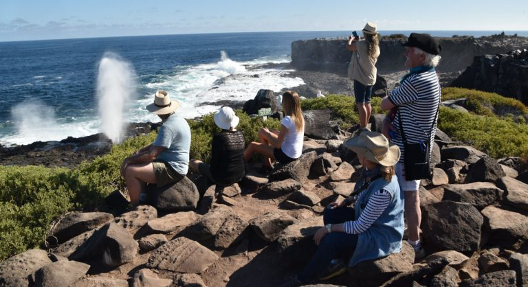 Suarez Point - Española in Galapagos Island Landscape view of the blowhole and tourist looking the sea
