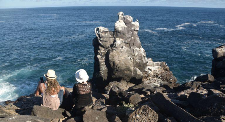 Suarez Point - Española in Galapagos Island, tourist looking the sea