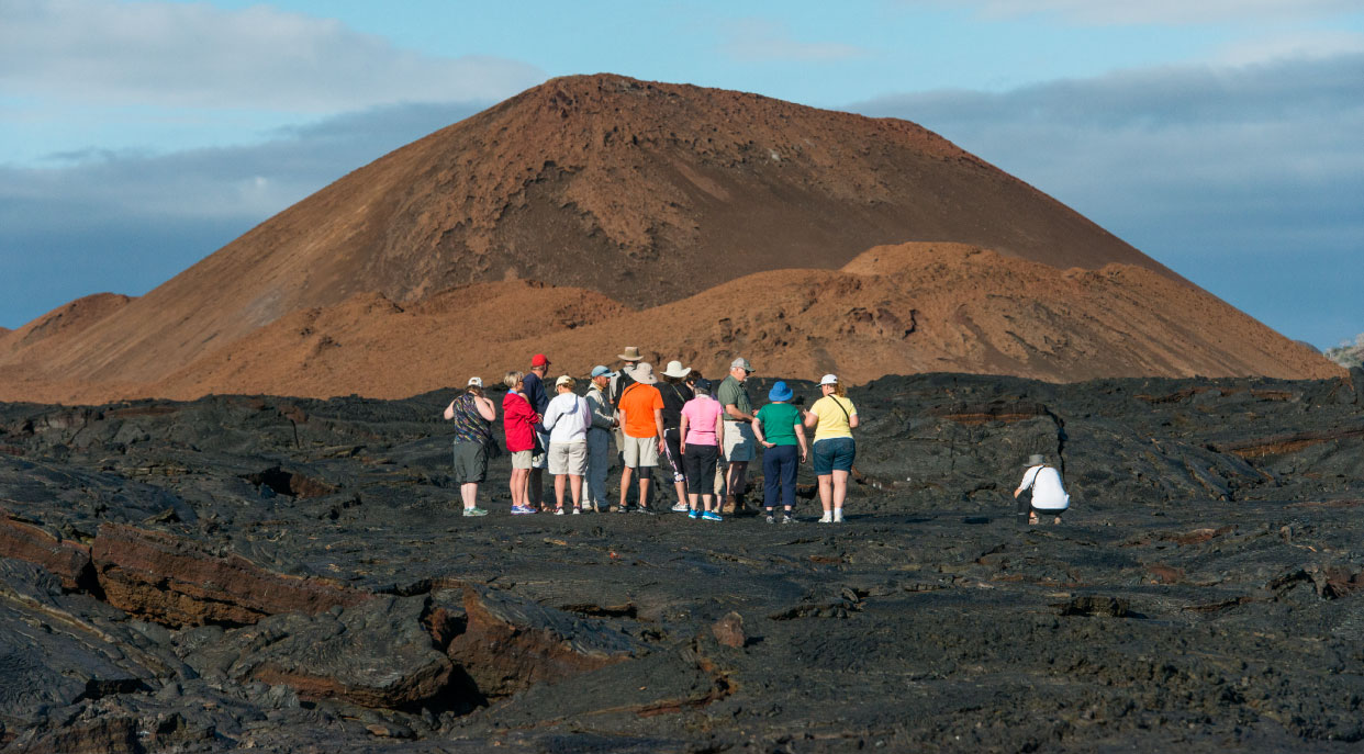 Sullivan bay, solid volcanic lava with tourist watching all