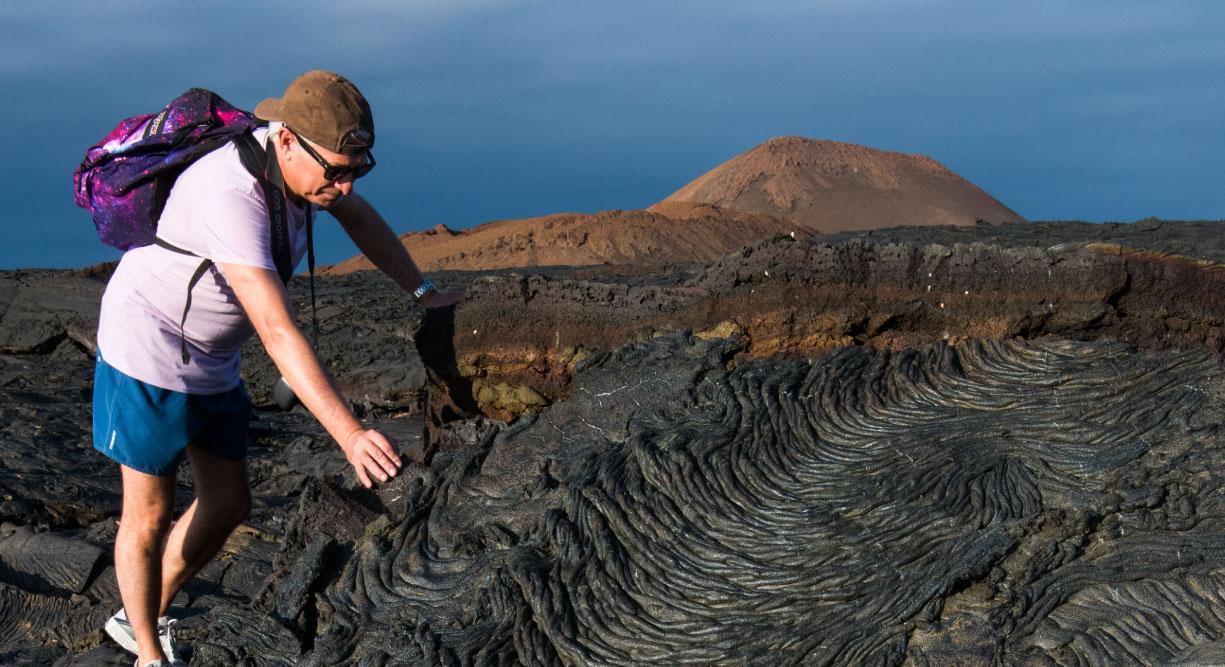 Sullivan bay in Santiago Island, solid volcanic lava with tourist
