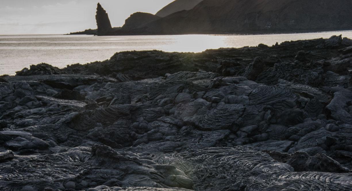 Sullivan bay in Santiago Island, solid lava with backgroud of the bartolome island