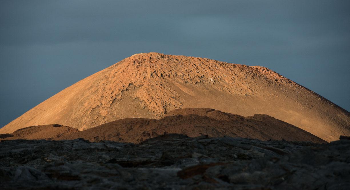 Sullivan bay in Santiago Island, view of the volcano