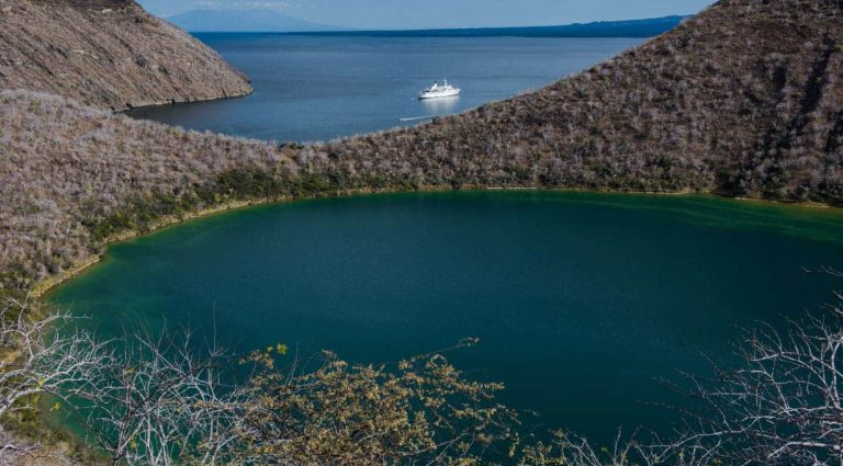 Tagus Cove - Isabela in the Galapagos, view of the Galapagos Legend in the sea over the horizon